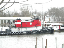 Tugboat on the river in winter